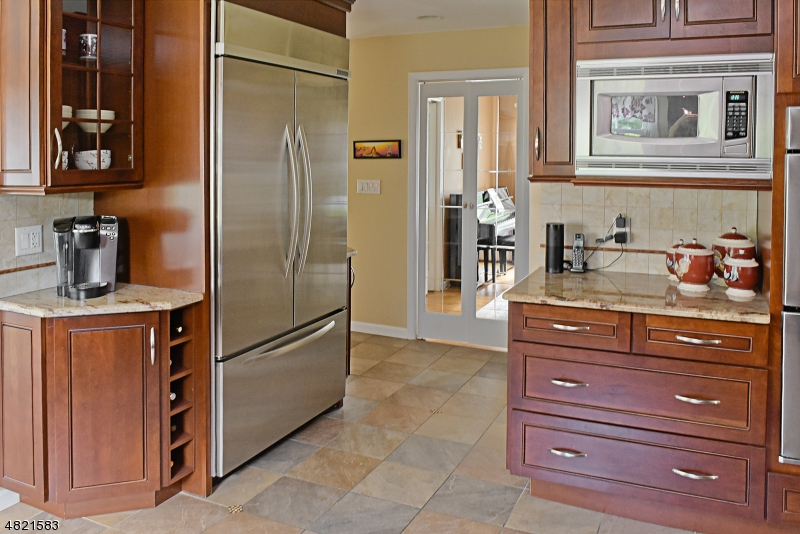Oversize refrigerator, Corner china section and more counter