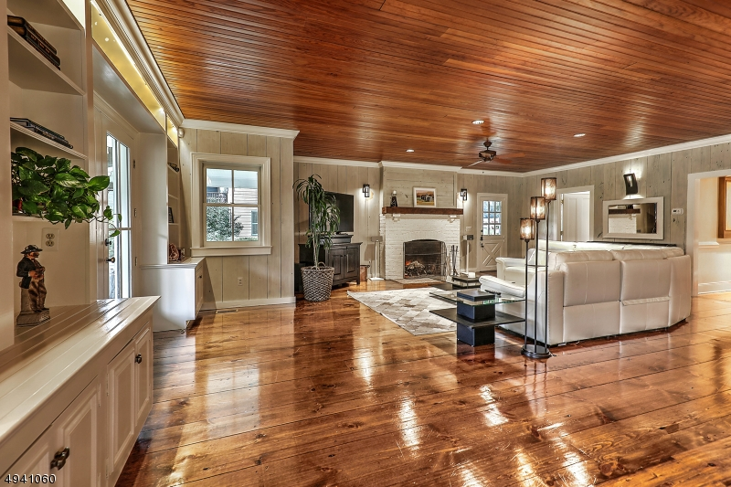 Family room with wood-burning fireplace is part of kitchen area