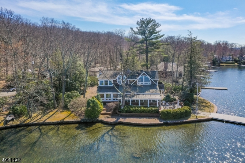 "A"" jewel in the crown"" of Green Pond, this custom home is set on a most coveted Green Pond property with breathtaking views from every vantage point!"