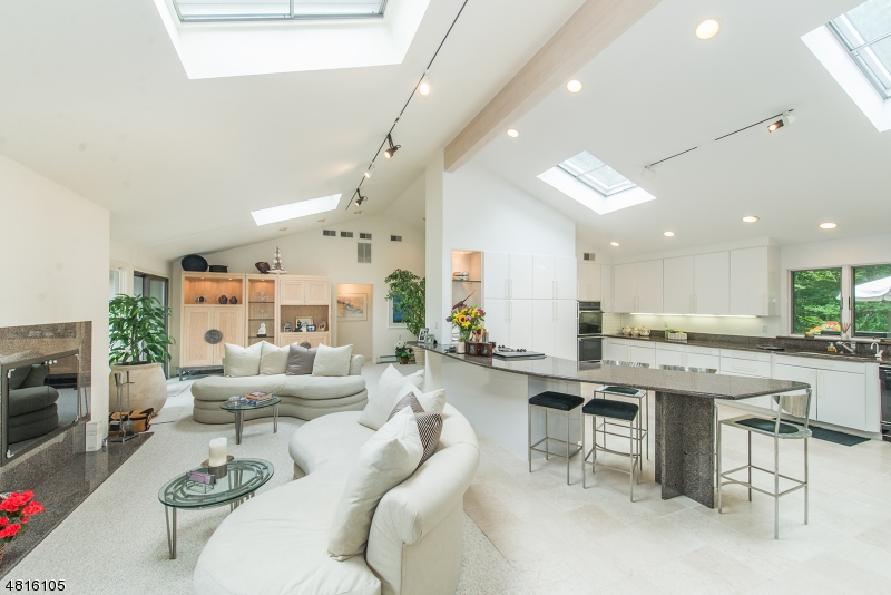 Open floor plan with high ceilings and lots of windows to see the beautiful surroundings