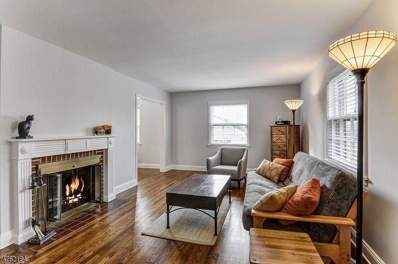 Hardwood floors and wood burning fireplace.