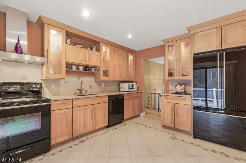 Custom cabinetry w in-lay glass, lights custom tile work