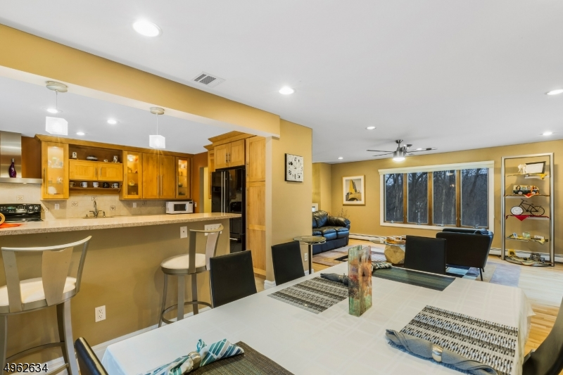 view of living room and kitchen.   Great setup for entertaining guests or just hanging out with family