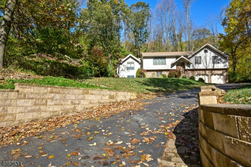 Retaining walls guide you along driveway to expanded parking