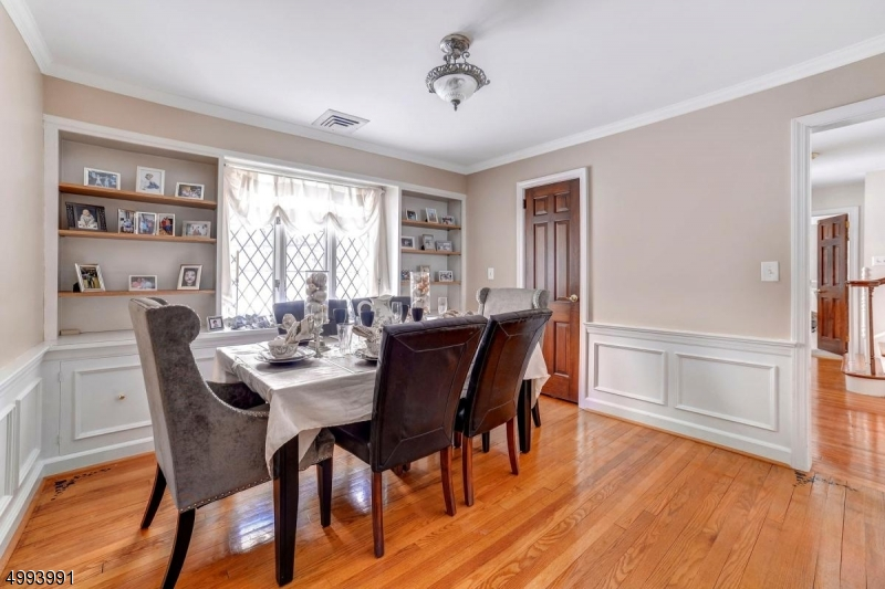 Beautiful hardwood floors.Room has the possibility to be used for many possibilities with its built shelving and location in the home There is a separate dining room