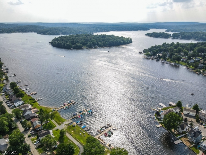 Home is located in quiet cove with access to community docks and Big Water!  Community beach.