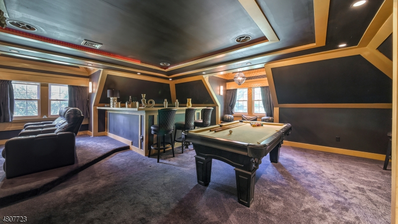 Fashionable and impresssive recreation/lounge area with bar and theater.