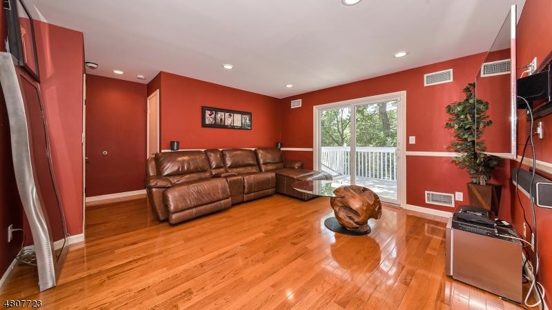 Wood floors, sliders to balcony overlooking rear property gardens.