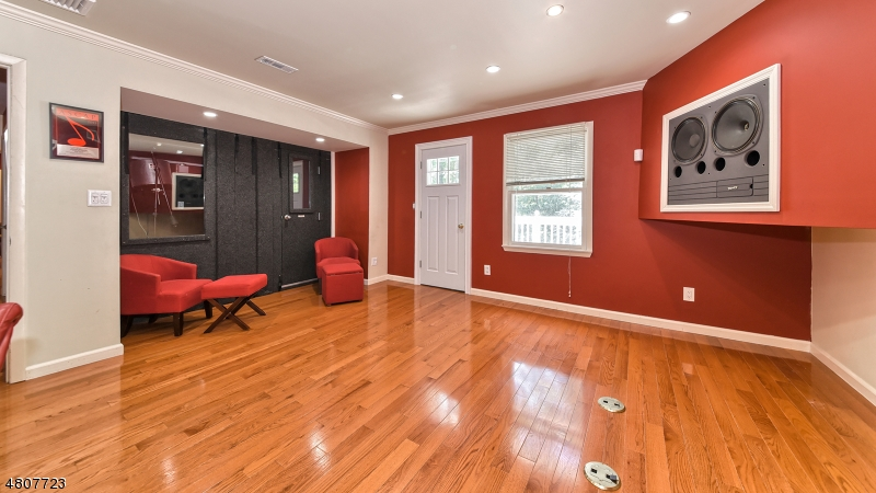 Wood floors, access to balcony. This room is adjoined to another room. Previous use was 2 bedrooms.