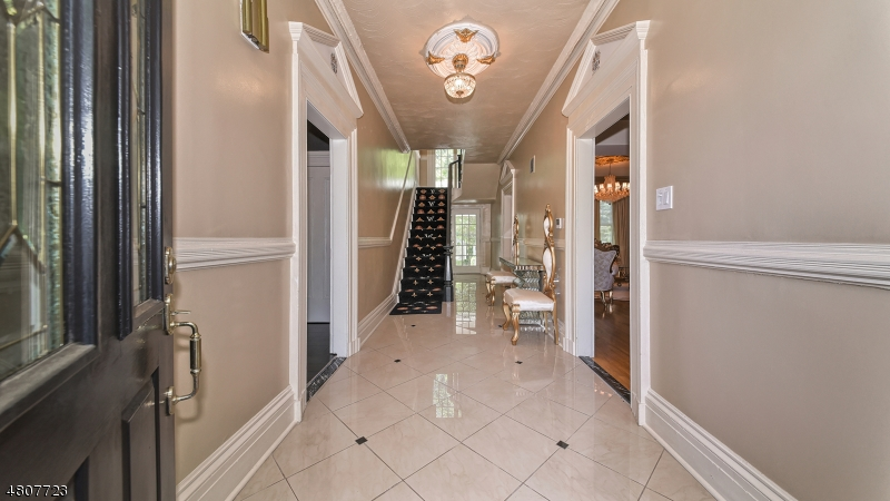 Original staircase and balusters, crown moldings, floor moldings, chandelier medallion. Rear foyer is adjacent to family room w/rear grounds access.
