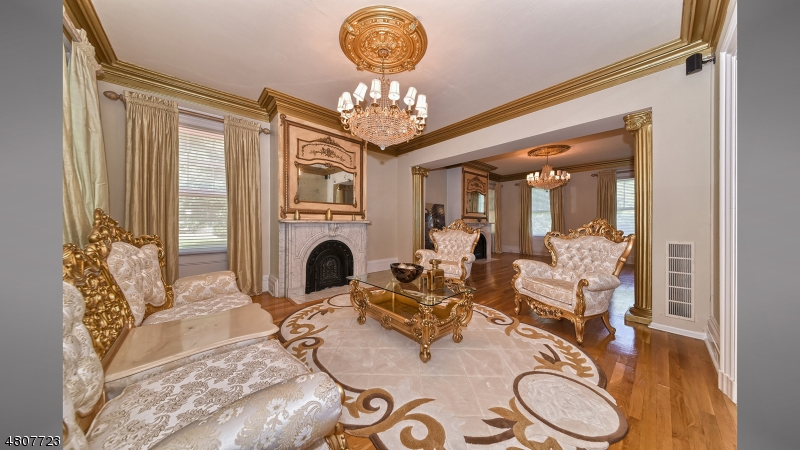 Adjoined by additional living area w/dual fireplaces, crown moldings, wood floors, chandelier medallions.