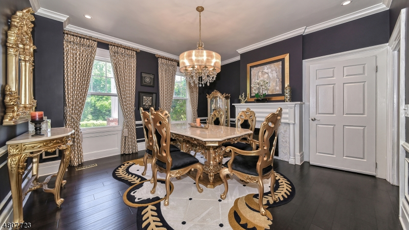 Wood floors, crown moldings, wainscoting, large base moldings, gas fireplace.
