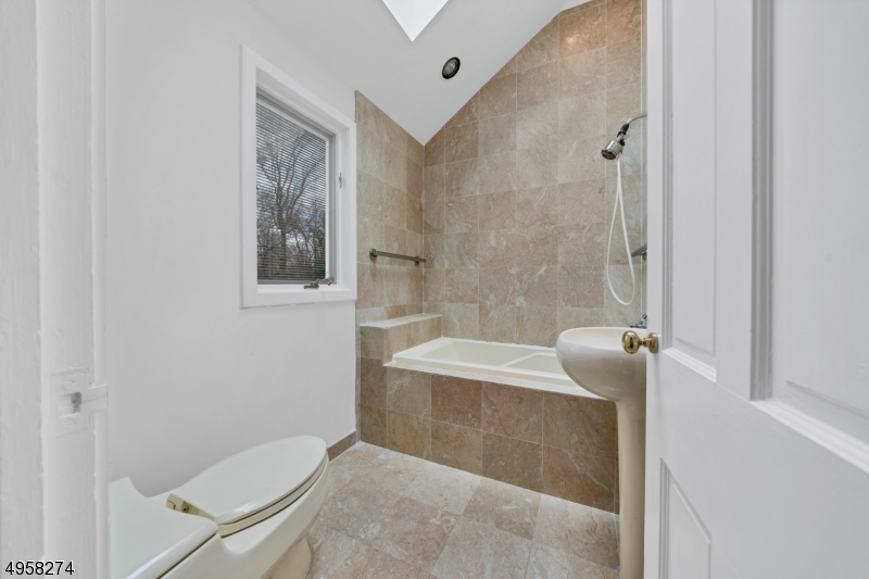 Marble bath has vaulted ceiling & Skylight. Separate Jetted Tub & Large Shower
