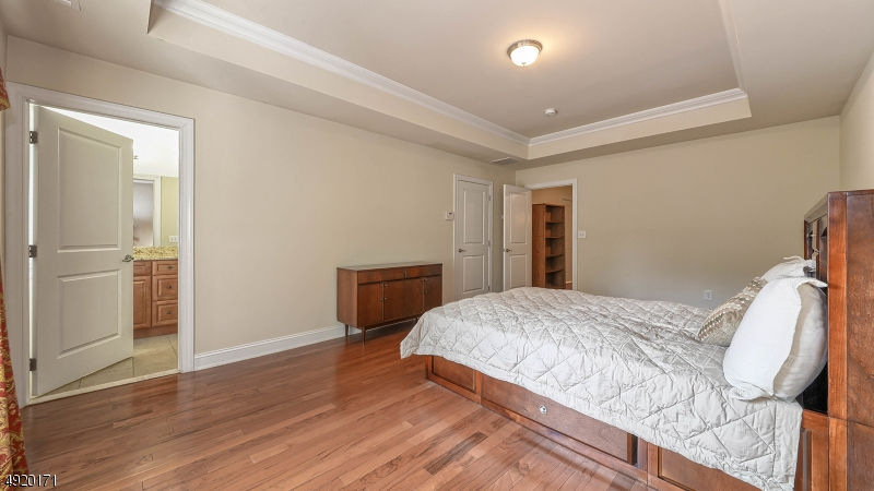 King bed fits easily in this room; hdwd floors.