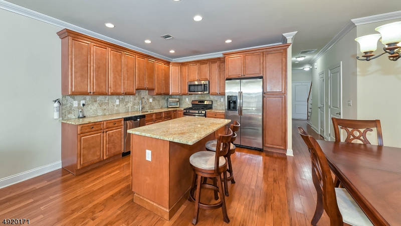 Kitchen with center island and granite counter tops.