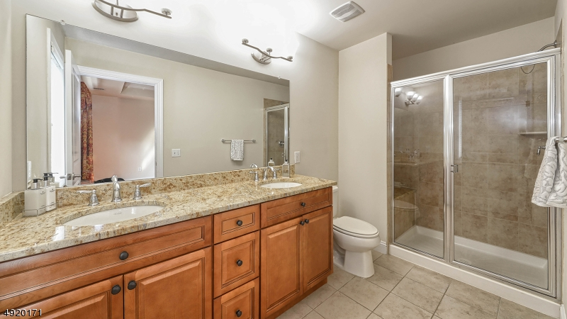Master bath with dual sinks + granite counter tops