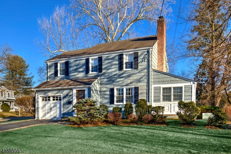 Located in Chatham's desirable Manor section, this charming Colonial offers great curb appeal on a tree-lined street. This three bedroom residence has spacious rooms enhanced by an abundance of windows and gleaming hardwood floors.