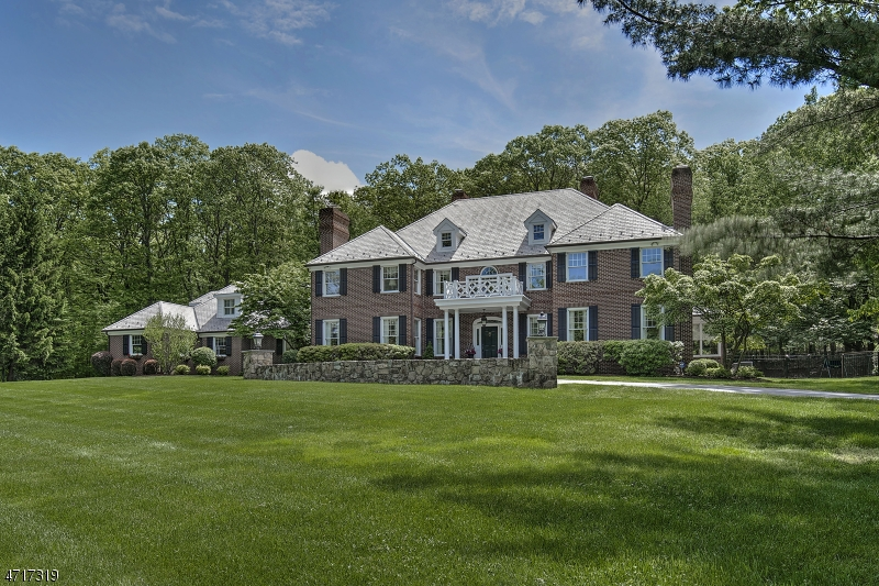 This stately home sits atop 3 maincured acres and is surrounded by parklands.