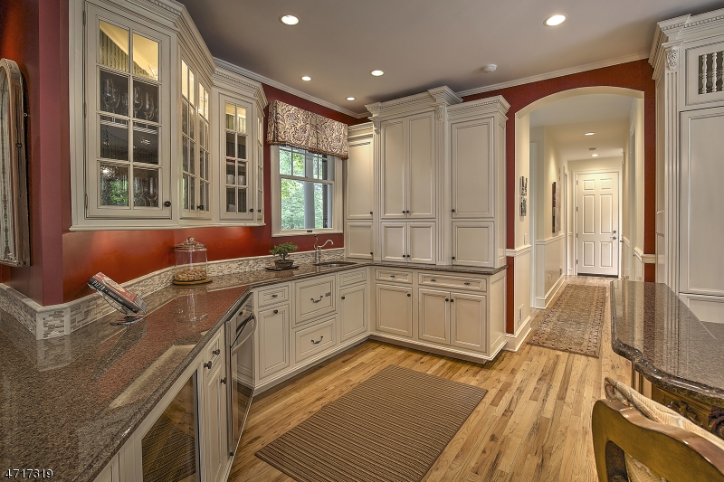 Kitchen has 2 sinks, 2 diswashers, 2 ovens, refigerator drawers, wine refigerator, etc.