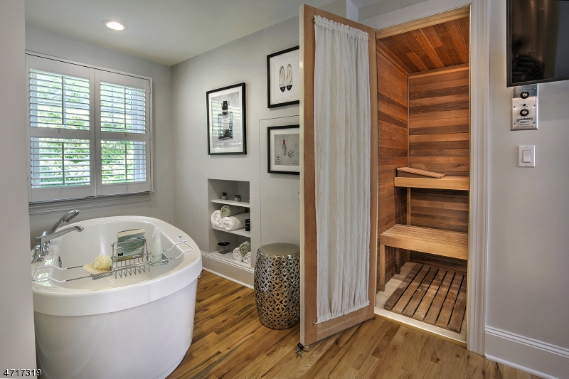Lovely tub and sauna area in the master bedroom.