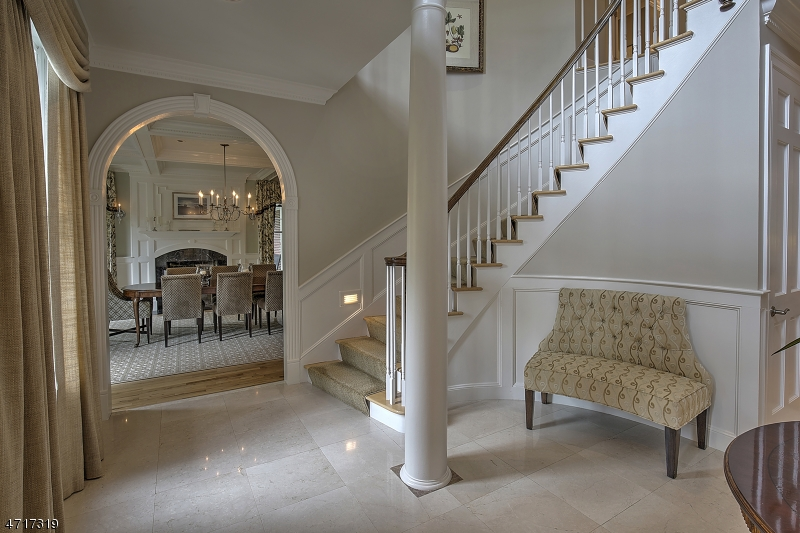 Gracious foyer with archways that lead into the dining room and living room.