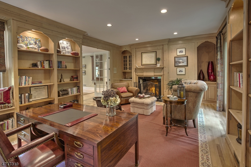 Large room size with custom pine cabinetry and fireplace.  Doorway to privace bluestone patio with fountain.