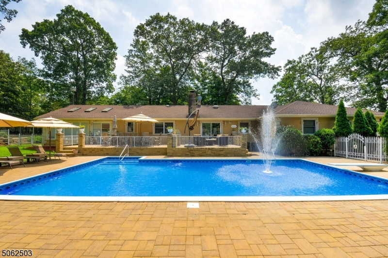 Beautiful backyard with paved patio and huge deck.
