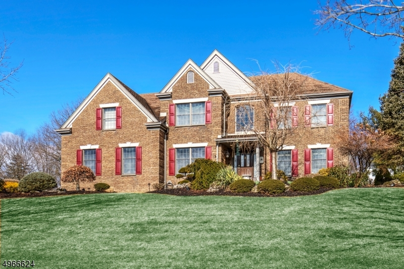 Stately brick front Colonial.