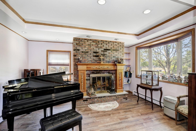 Trey ceiling, recessed lighting, wood-burning fireplace.