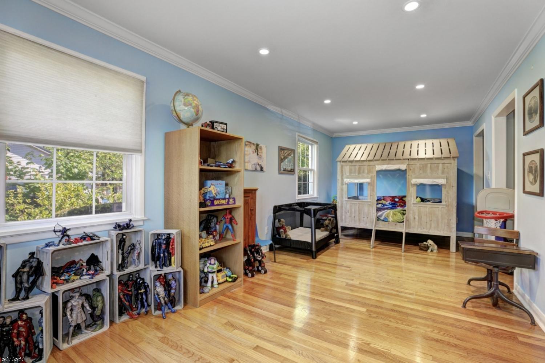 Wood floors, crown molding, recessed lighting, two custom closets.