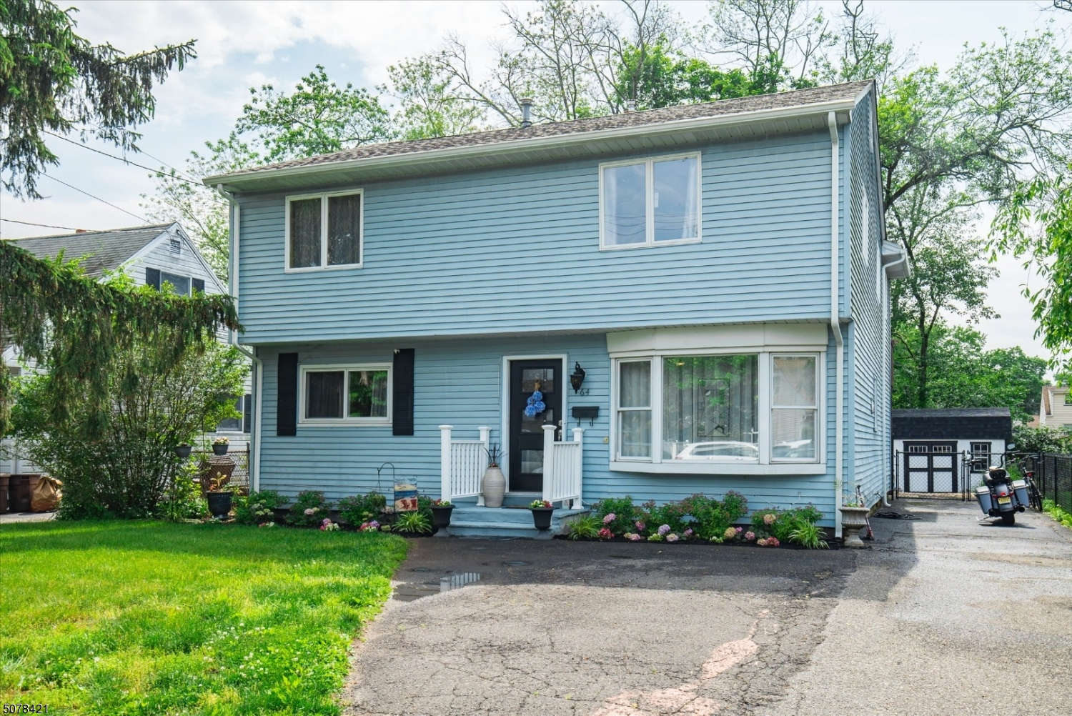 Beautifully renovated 5 bedroom Colonial home w/ great curb appeal.