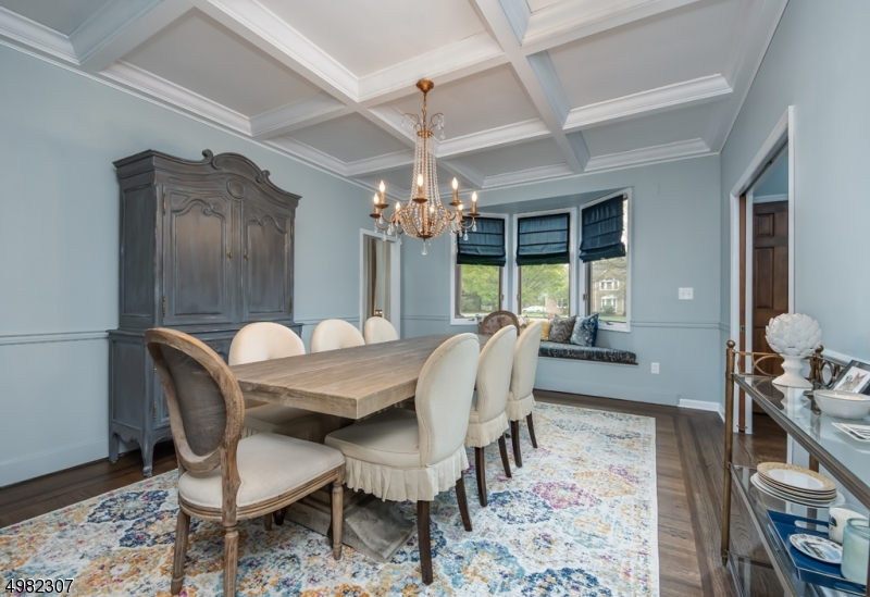 Dining room with gorgeous ceiling, hardwood floors and window seat