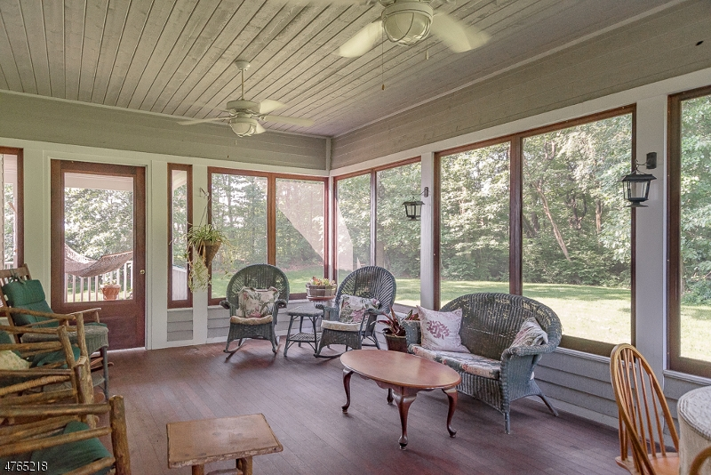 Relax in this exceptional room which leads out to the deck in the back or porch in the front There are peaceful ceiling fans and beautiful floor. Full windows which also can be changed to screens