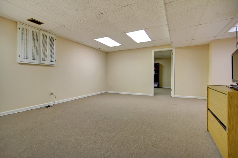 Great ceiling height! Rec Room with wall to wall carpeting