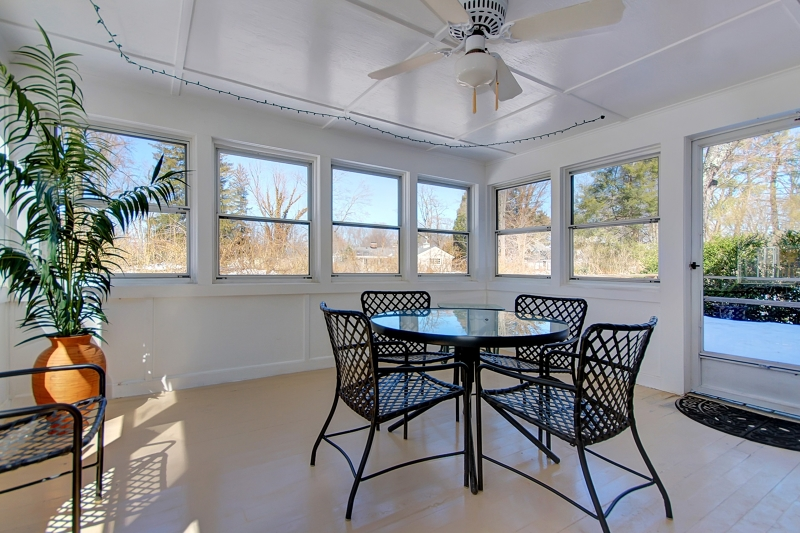 Door leads to deck and rear yard. 3 walls of windows offer pretty views