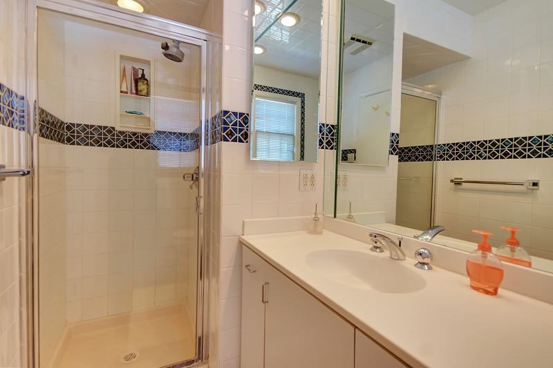 Sink with vanity for great storage and glass shower door