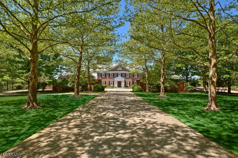 Reminiscent of a Georgian style Manor Home on 32+ acres.