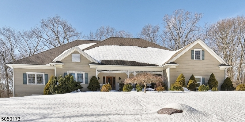 3236 sq ft ranch on 4 acres. Built in 2000. Walk-out basement and walk-up attic.