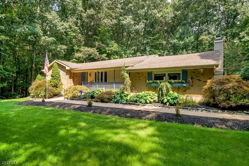 Welcome to this brick front ranch, located on 2.9 parklike acres!
