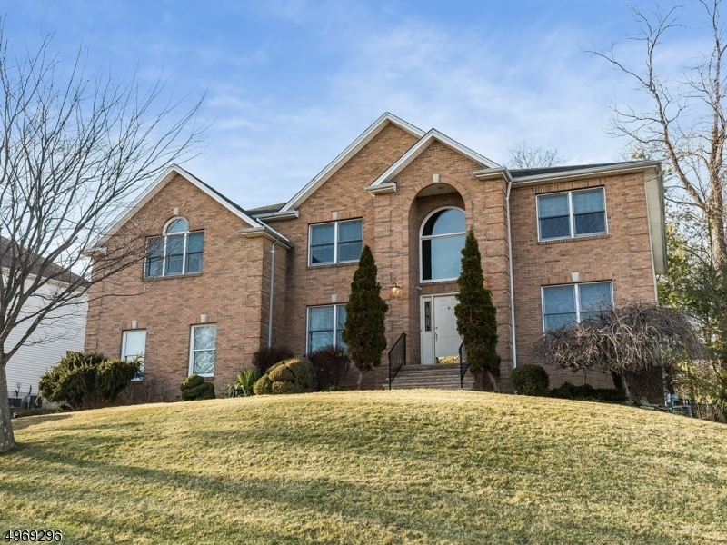 Stunning brick front Colonial creates a gracious presence in this desirable Wayne neighborhood, offering a ton of luxury living space!