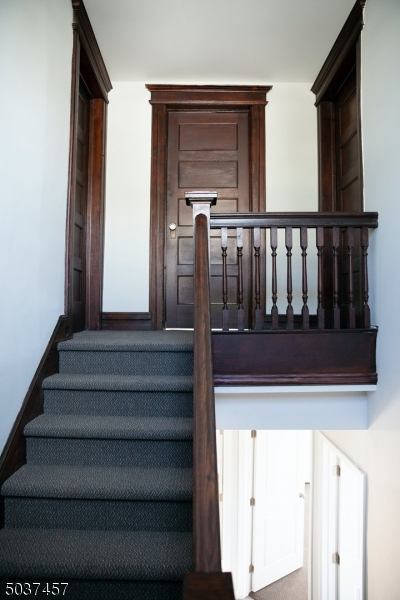 Original banister, moulding and doors. Two bedrooms plus storage room