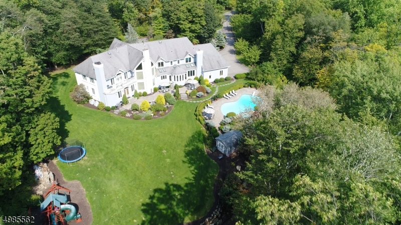 Private oasis situated on a 7+ acre property.