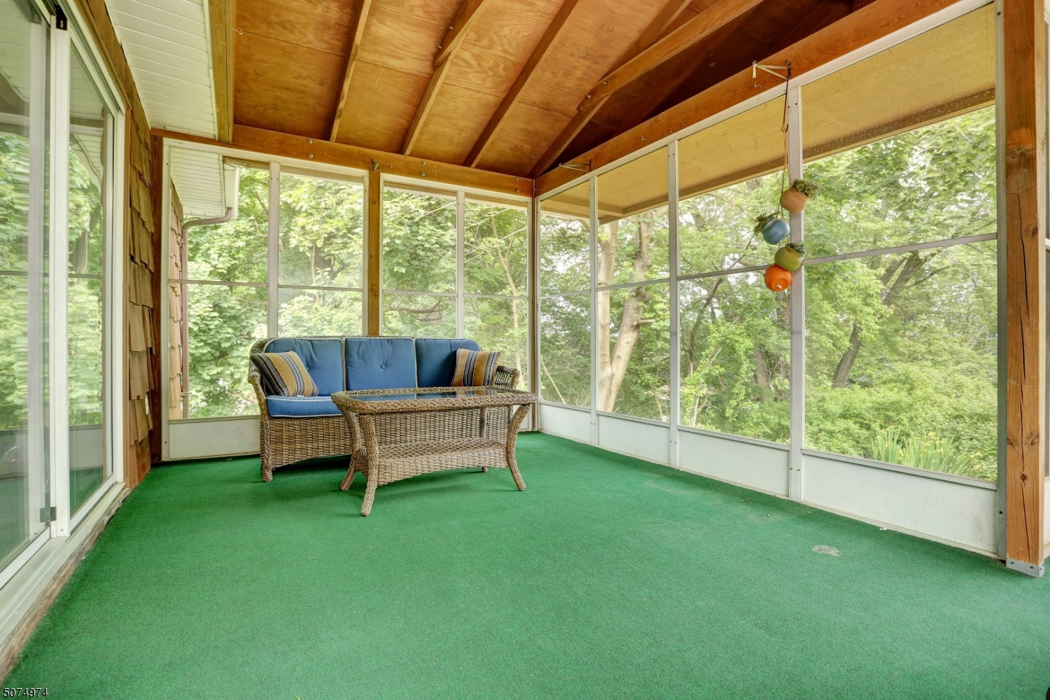 This screened porch is a dream! Enjoy Summer and Fall nights relaxing, while taking in the views of the mountains in the distance. Perfect for another entertainment option as the screened door leads out to the deck.