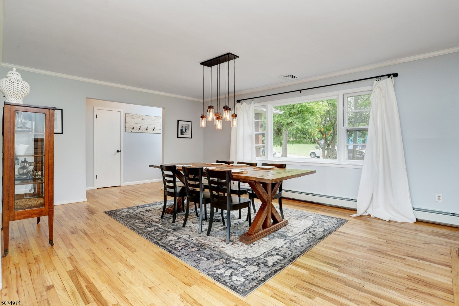 Brilliant, updated, open concept floor plan with refinished hardwood floors.  A large picture window with two side double-hung windows allow for tons of natural sunlight into this already bright and airy room.