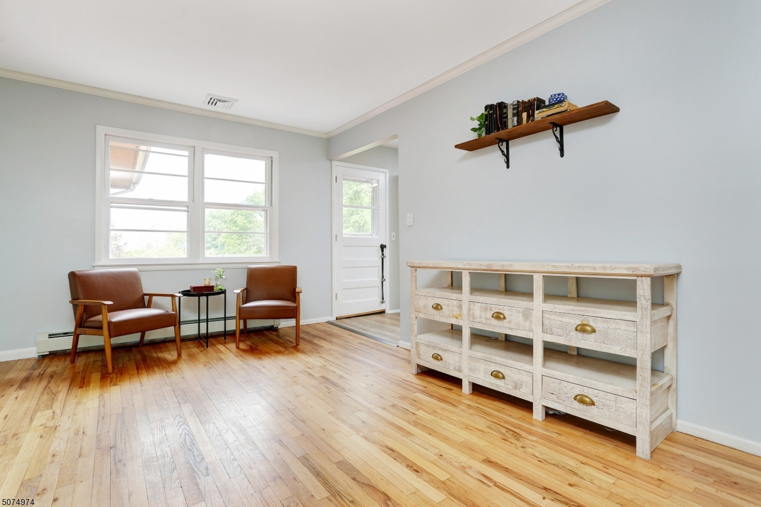 Newly refinished hardwood floors surround the perimeter of this additional dining area. Two double hung windows contribute tons of natural sunlight to this already radiant room.