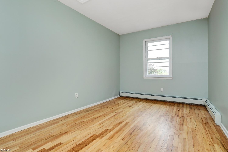 Double-hung window with newly refinished hardwood floors.