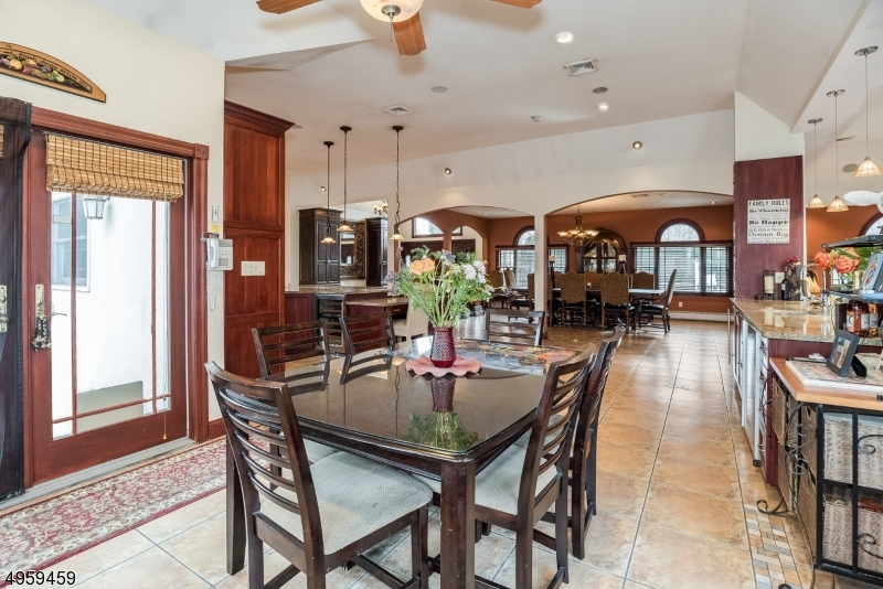 The unique open floor plan seamless flows from the living area, through the kitchen to the dining area, and into the back entertaining area.