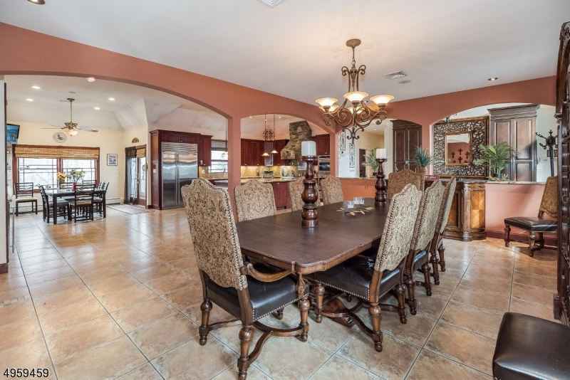 Enjoy sit-down dinners and larger formal gatherings in the sophisticated formal Dining room. Elegant archways separate the Dining space from the Living room and Kitchen areas.