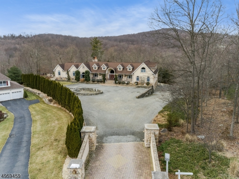 Private entry leads you to the custom impressive Ranch that offers 7,000 sq ft of luxurious living space! Upon arrival you are greeted by the large front circular driveway that offers a plenty of additional parking.