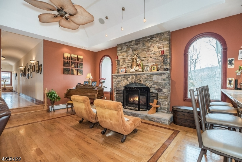 Cozy up next to the eye-pleasing stone stacked fireplace and enjoy both it's warmth and ambiance.